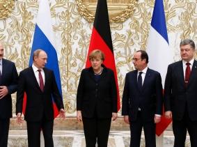 Belarus' President Alexander Lukashenko, Russia's President Vladimir Putin, Germany's Chancellor Angela Merkel, France's President Francois Hollande, and Ukraine's President Petro Poroshenko at peace talks in Minsk, February 11, 2015