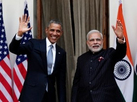 U.S. President Barack Obama and India's Prime Minister Narendra Modi wave before their meeting at Hyderabad House, New Delhi, January 25, 2015