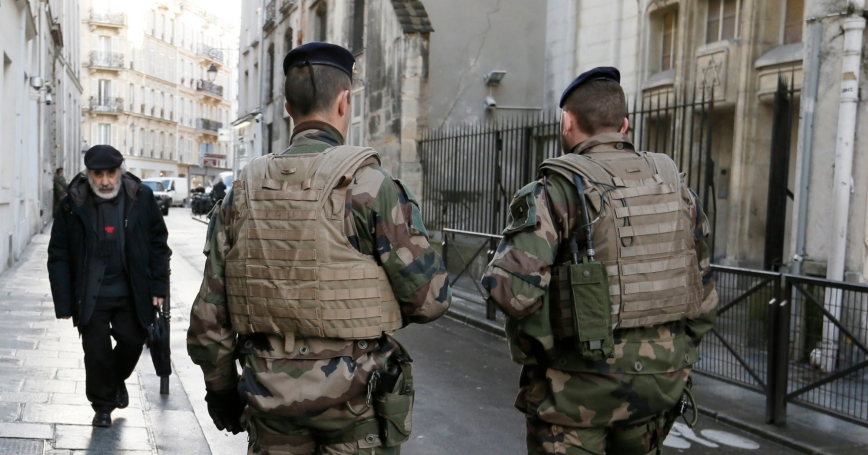 French soldiers patrol a Jewish neighborhood near a religious school and a synagogue as part of the highest level of 'Vigipirate' security plan