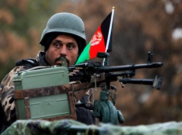 An Afghan National Security Forces soldier keeps watch in Kabul, November 23, 2013