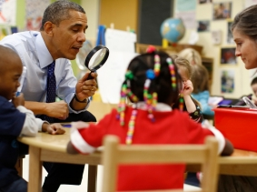 U.S. President Barack Obama playing a game with children in a pre-kindergarten classroom, photo by Jason Reed/Reuters