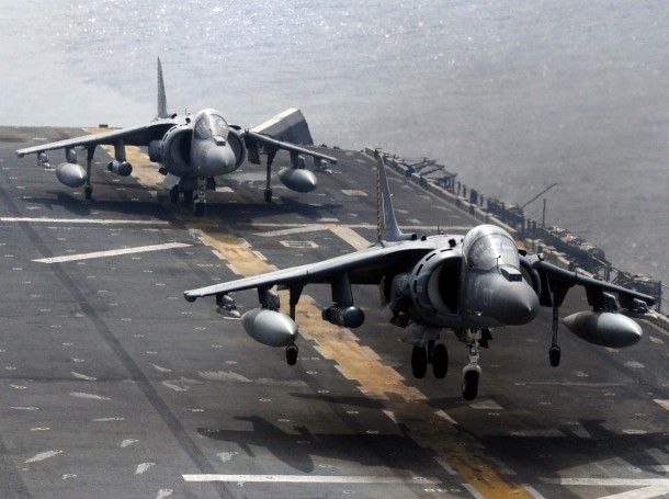 An AV-8B Harrier jet aircraft prepares to land aboard the USS Essex in the Philippine Sea