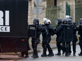 French special intervention police conduct a house-to-house search in Longpont, northeast of Paris, January 8, 2015