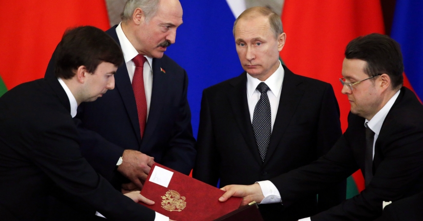Russia's President Vladimir Putin and his Belarusian counterpart Alexander Lukashenko (2nd L) attend a signing ceremony during a session of the Supreme State Council of the Union State at the Kremlin in Moscow, March 3, 2015