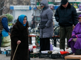 After a year of political upheaval and a war in the East, Ukrainians are facing poverty, with prices rising sharply, the currency crumbling, and a nearly bankrupt state, photo by Valentyn Ogirenko/Reuters