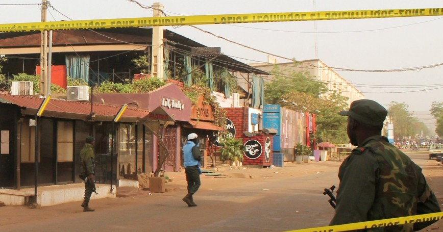 A soldier stands outside La Terrasse restaurant where militants killed five people in a gun attack in Bamako, Mali, March 7, 2015