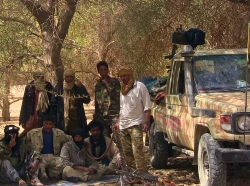 Fighters from the Tuareg separatist rebel group MNLA take shade under a tree in the desert near Tabankort, February 13, 2015