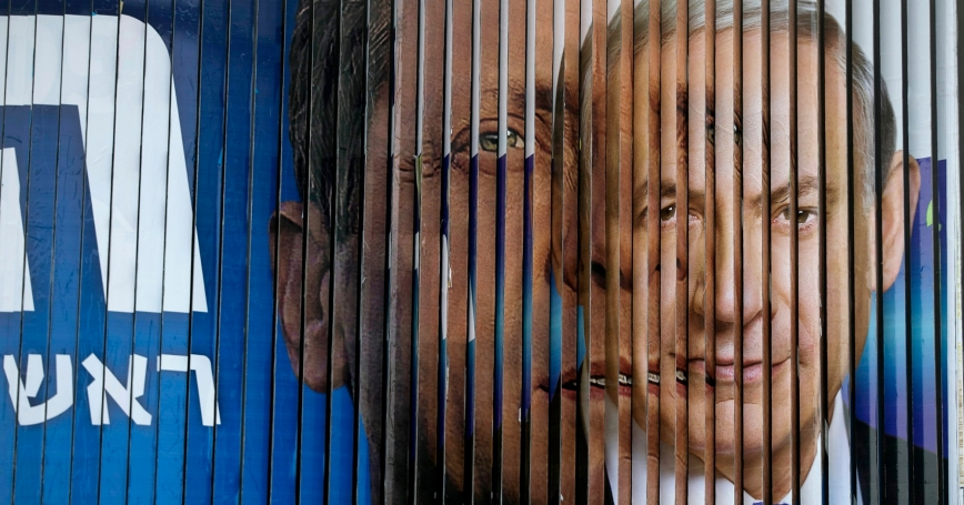 Israel's Prime Minister Benjamin Netanyahu and Isaac Herzog of the Zionist Union, as campaign billboards rotate in Tel Aviv, March 9, 2015