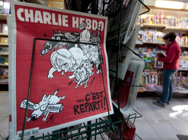 The new issue of satirical French weekly Charlie Hebdo titled 'C'est Reparti' ('Here we go again') in Nice,
