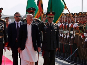 Afghanistan's President Ashraf Ghani inspects the honour guard during a graduation ceremony at the National Military Academy in Kabul, March 18, 2015