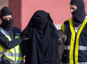Spanish police arresting a woman suspected of recruiting women to go to Syria and Iraq to support Islamic State insurgents, photo by Jesus Blasco de Avellaneda/Reuters