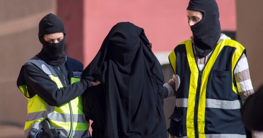 Spanish police arresting a woman suspected of recruiting women to go to Syria and Iraq to support Islamic State insurgents. Credit: Jesus Blasco de Avellaneda/Reuter