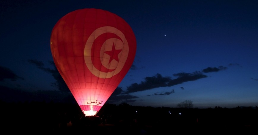 A balloonist fires the burners of his hot air balloon during the Tunisian Balloon Festival in Hammamet March 22, 2015