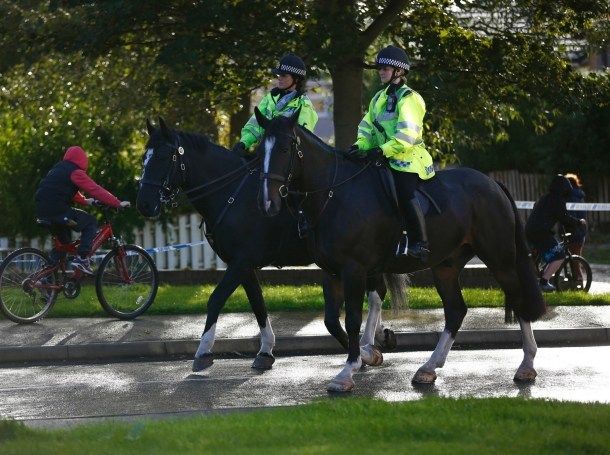 Mounted police patrol Hattersley near Manchester, northern England