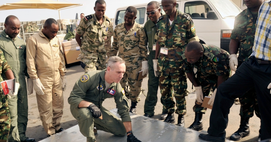 U.S. Senior Master Sgt. Leonard discusses cargo pallet inspection procedures with East Africa air force members during African Partnership Flight-Djibouti February 10, 2015