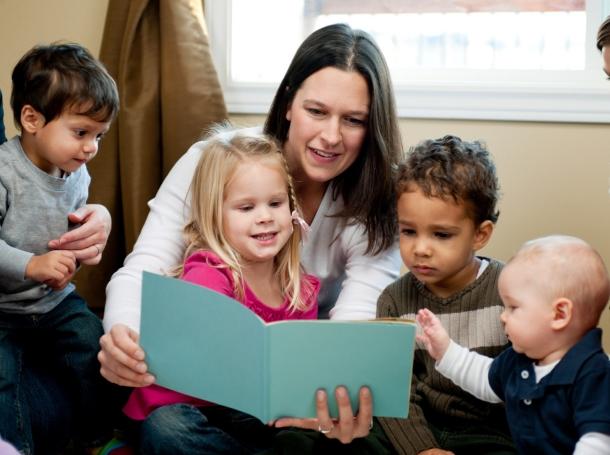 Preschool teachers or caregivers reading to children