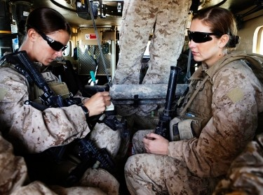 U.S. Marine Sgt. Sheena Adams and H.N. Shannon Crowley in an armored vehicle in southern Afghanistan's Helmand province, November 13, 2010