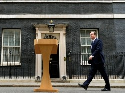 Britain's Prime Minister David Cameron prepares to speak as he returns to Number 10 Downing Street on March 30, 2015
