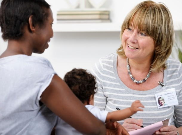 Social worker conducting a home visit with a new mother