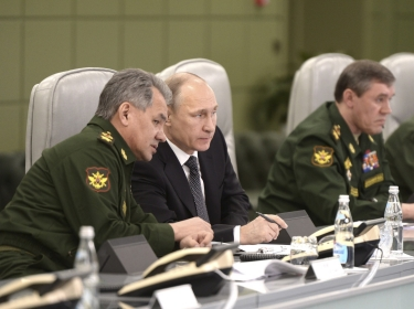 Russian President Vladimir Putin at the national defence control centre with Defence Minister Sergei Shoigu (L) and armed forces Chief of Staff Valery Gerasimov, in Moscow, April 17, 2015