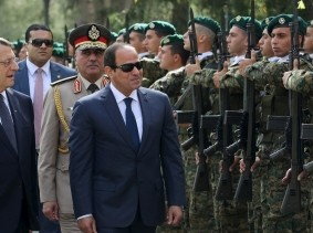 Cypriot President Nicos Anastasiades and Egyptian President Abdel Fattah al-Sisi observe a guard of honour at the Presidential Palace in Nicosia, April 29, 2015, photo by Yiannis Kourtoglou/Reuters