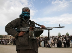 A member of the Taliban insurgency during the execution of three men in Ghazni Province, April 18, 2015