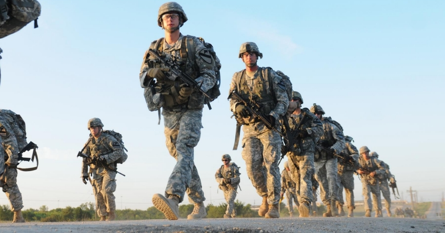Platoon leaders and platoon sergeants marching during the Headhunter leadership challenge at Fort Hood, Texas, Aug. 15, 2014