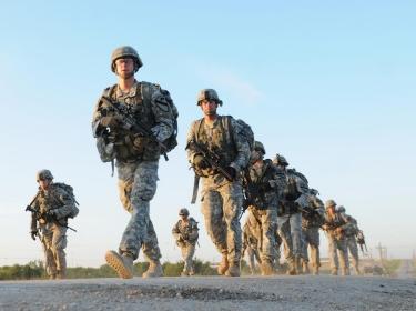 Platoon leaders and platoon sergeants marching during the Headhunter leadership challenge at Fort Hood, Texas, Aug. 15, 2014