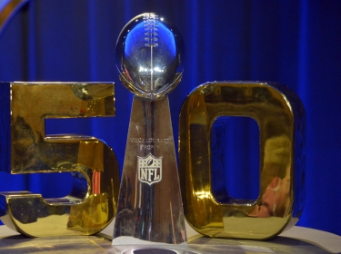 The Vince Lombardi Trophy and the Super Bowl 50 logo prior to a press conference at Moscone Center in San Fransisco, California