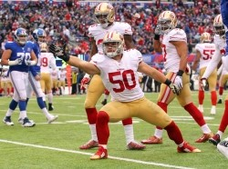 San Francisco 49ers linebacker Chris Borland signals a first down after an interception against the New York Giants at MetLife Stadium, November 16, 2014