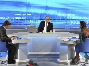 Russian President Vladimir Putin takes part in a live broadcast nationwide call-in in Moscow April 16, 2015; he said Russian military forces were not in Ukraine, denying allegations that Moscow is providing troops and support for pro-Russian rebels fighting in eastern Ukraine