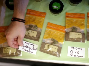 Labels with prices are placed next to marijuana for sale at the grand opening of The Cannabis Corner, the first city-owned recreational marijuana store in the country, in North Bonneville, Washington March 7, 2015