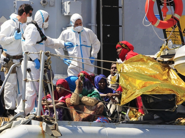 Migrants stand on board of Italian Navy ship Chimera before disembarking in the southern harbour of Salerno April 22, 2015