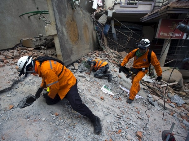 Nepalese military personnel and international rescue crews check on a collapsed building after the earthquake in Kathmandu, Nepal, May 12, 2015