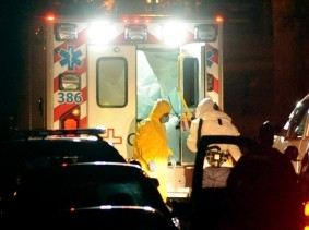 Texas nurse Amber Vinson, who had treated Liberian Ebola patient Thomas Eric Duncan, exits an ambulance at Emory University Hospital in Atlanta, October 15, 2014