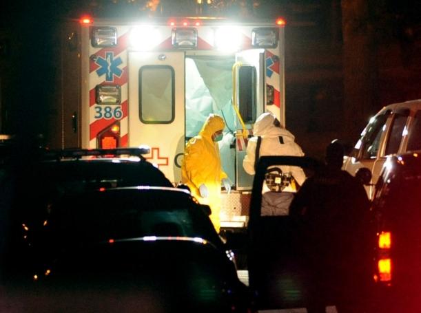 Texas nurse Amber Vinson, who had treated Liberian Ebola patient Thomas Eric Duncan, exits an ambulance at Emory University Hospital in Atlanta, October 15, 2014