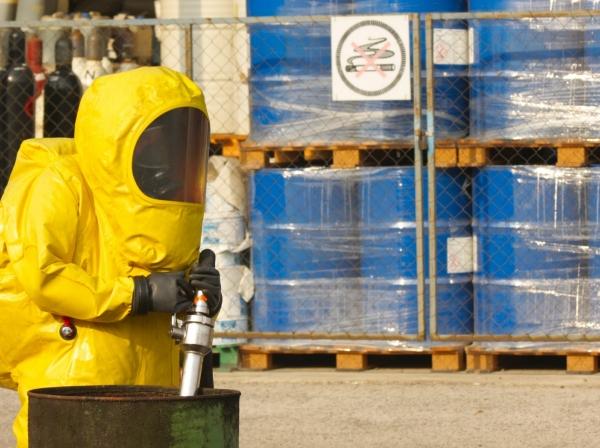 Worker wearing a hazmat suit