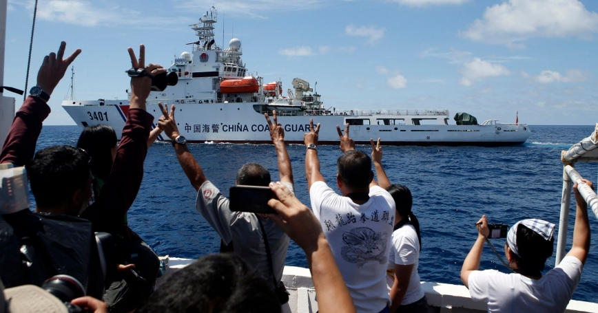 A Chinese Coast Guard vessel in the South China Sea maneuvers to block a Philippine supply ship with members of the media aboard, March 29, 2014