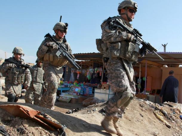 U.S. Army Soldiers walk through a market in Ebnkathwer, Iraq, March 3, 2010