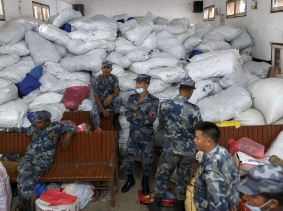 Nepal military personnel sits next to relief supplies at Gorkha district office following Saturday's earthquake in Gorkha, Nepal April 30, 2015, photo by Athit Perawongmetha/Reuters