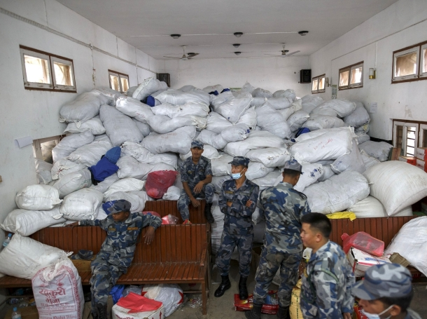 Nepal military personnel sits next to relief supplies at Gorkha district office following Saturday's earthquake in Gorkha, Nepal April 30, 2015