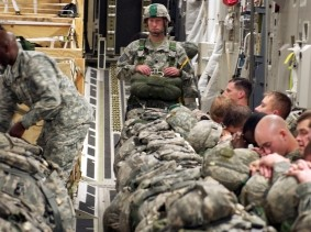 Soldiers from the 505th Parachute Infantry Regiment catch a few winks before jumping over North Carolina during a training exercise