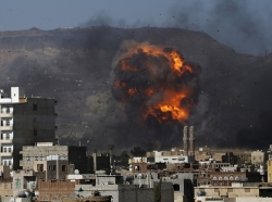 An air strike hits a military site controlled by the Houthi group in Yemen's capital Sanaa May 12, 2015