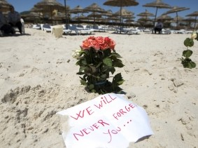 Flowers at the beachside of the Imperial Marhaba resort, which was attacked by a gunman in Sousse, Tunisia, June 28, 2015, photo by Zohra Bensemra/Reuters