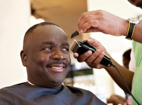 Man at a barber shop getting a haircut