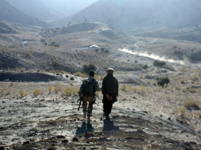 An Afghan border policeman escorts a detained suspected Taliban fighter near Walli Was in Paktika province near the border with Pakistan November 5, 2012, photo by Goran Tomasevic/Reuters