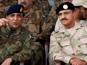 Pakistani Army Chief General Ashfaq Parvez Kayani talks with Royal Saudi Land Forces Commander Lieutenant General Khalid Bin Bandar Bin Abdul Aziz Al-Saud at a joint military exercise in Mangla, Pakistan, October 6, 2011, photo by Faisal Mahmood/Reuters