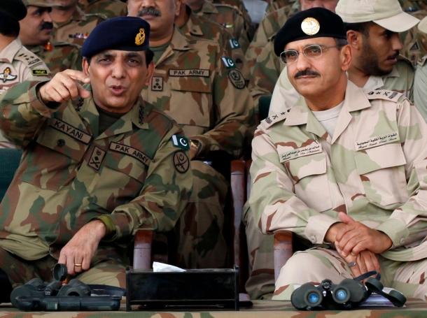 Pakistani Army Chief General Ashfaq Parvez Kayani talks with Royal Saudi Land Forces Commander Lieutenant General Khalid Bin Bandar Bin Abdul Aziz Al-Saud at a joint military exercise in Mangla, Pakistan, October 6, 2011