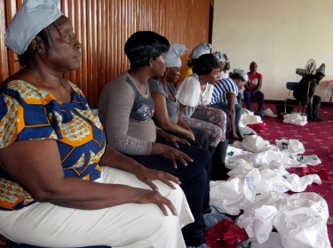 Trainee health workers preparing to don protective suits at a World Health Organization training session in Freetown September 30, 2014