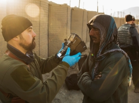 A contractor captures biological data of a local man in the Laghman province of Afghanistan, December 14, 2014, photo by Lucas Jackson/Reuters